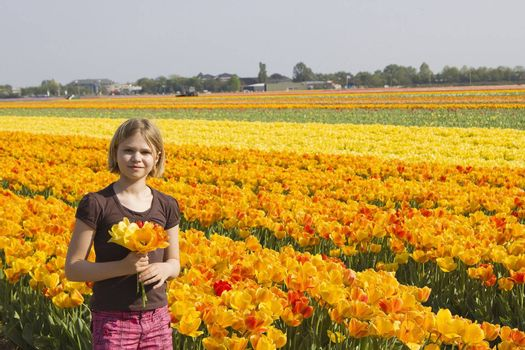 little girl in tulips field