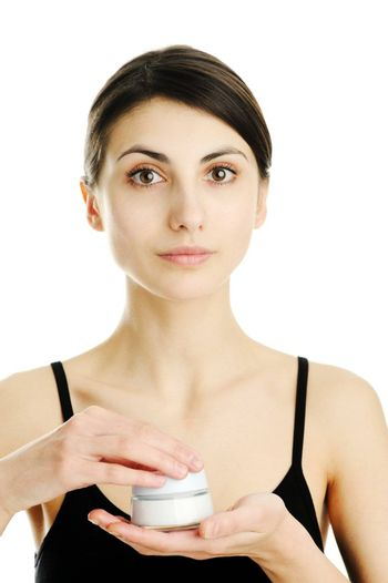An image of a young woman with facial cream
