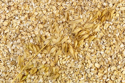 The texture of oatmeal with a stalk of oats