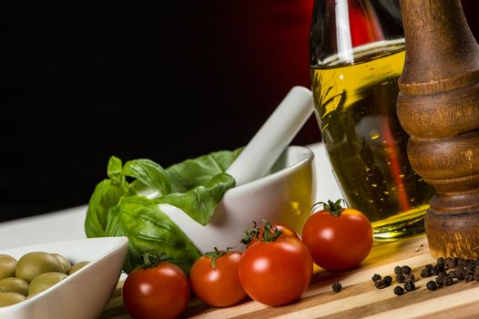 Pepper mill and fresh vegetables - horizontal close up