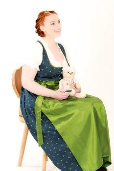 Stitz Bavarian woman with teddy bear on a chair