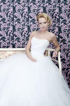 Bride sitting with slight smirking