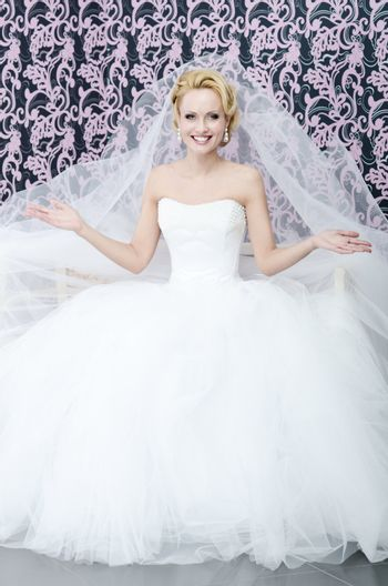 Bride with smile and opened arms