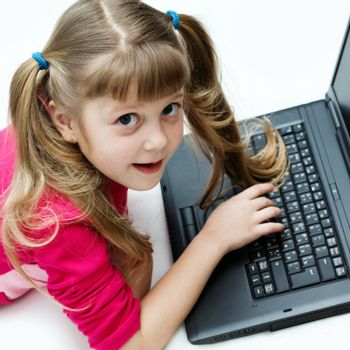 Stock photo: an image of a nice little girl with black laptop