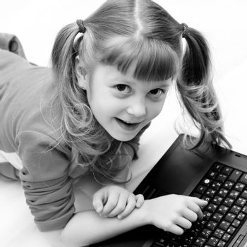 Stock photo: an image of a nice girl with black laptop