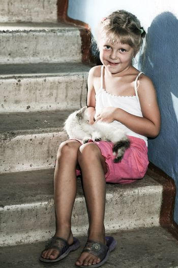 Friends. Smiling girl with a kitten in her arms