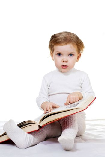 Stock photo: an image of a baby with a big book
