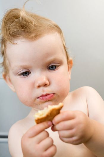 an image of baby eating white bread