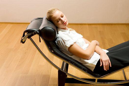 woman lying on chaise longue