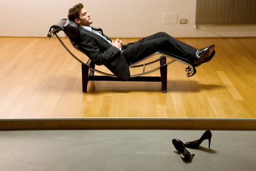 man lying on chaise longue