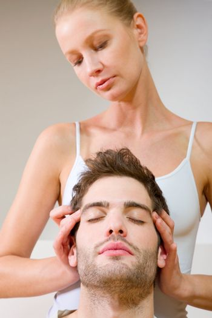 woman massaging man's temples