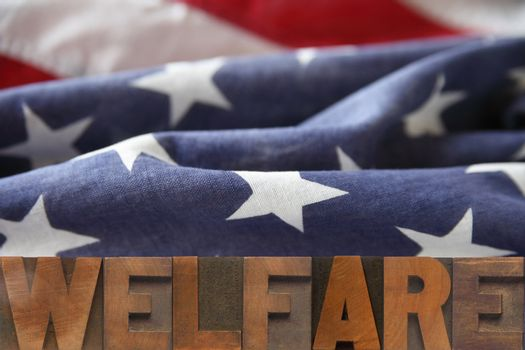 the word welfare on an American flag background