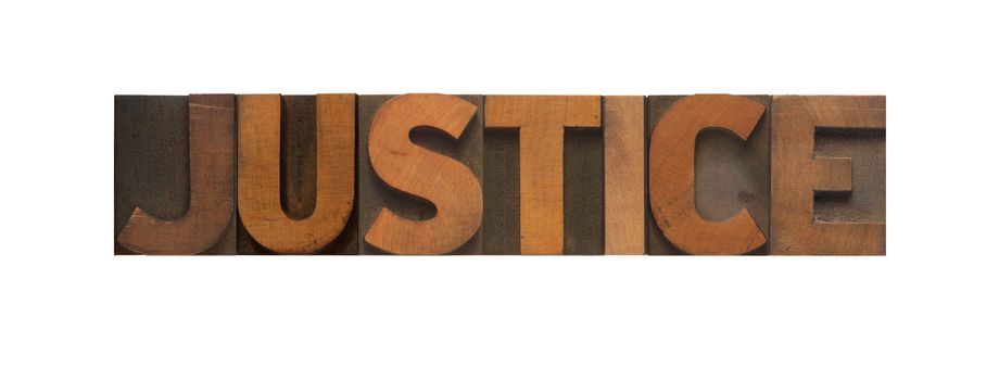 the word justice in old wood type