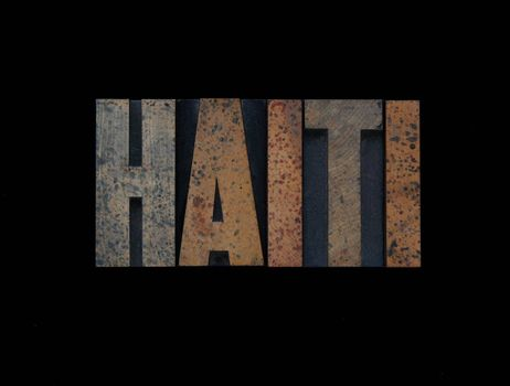 the word Haiti in old wood type