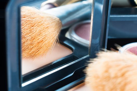 Make Up Reflected in Compact Mirror
