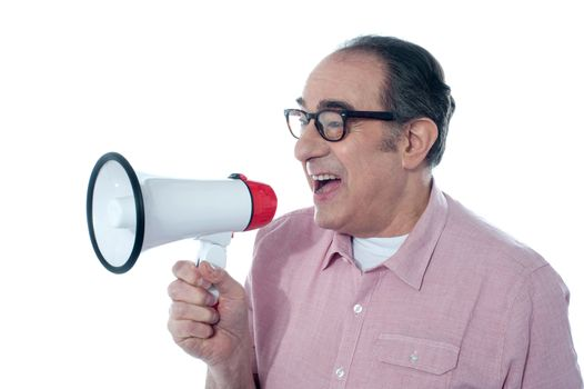 Old person shouting into a big speaker on white background