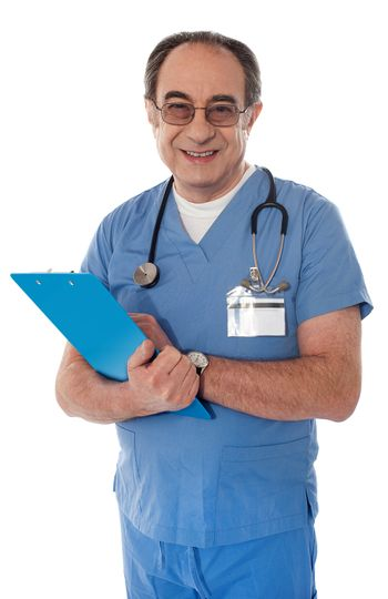 Experienced doctor holding reports and smiling at camera