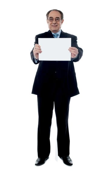 Senior business professional showing blank clipboard to camera isolated on white