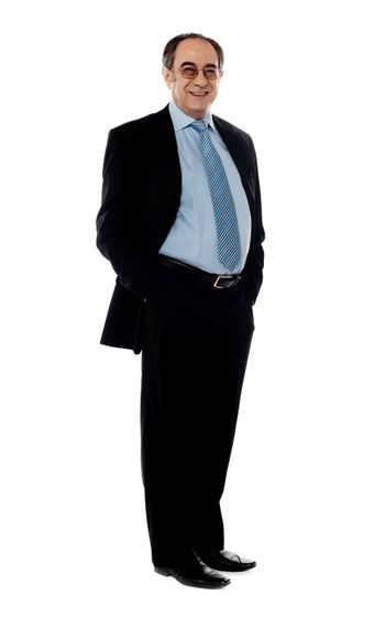 Company director posing in style with arms in pocket