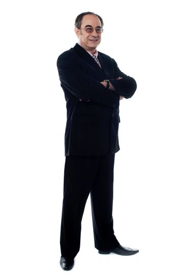 Senior manager posing with folded arms isolated on white background