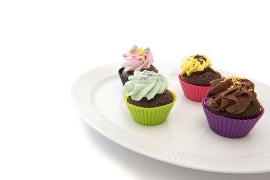 Cupcakes on dish. Copyspace