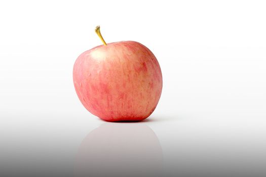 a juicy red apple on a white background ,Isolated