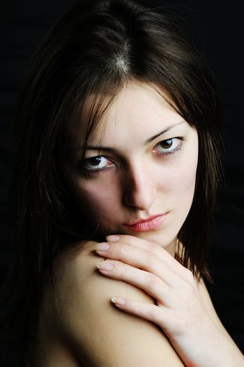 An image of a young beautiful woman close-up