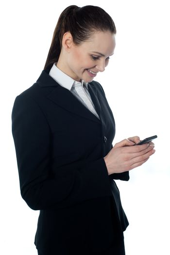 Corporate lady reading sms on cell phone, isolated on white
