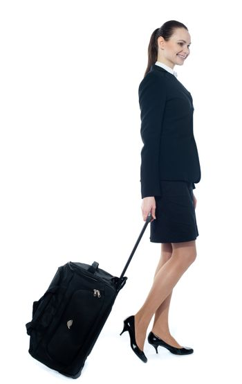 Businesswoman with a trolley bag isolated on white background