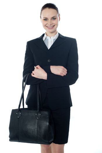 Corporate lady holding a handbag isolated over white