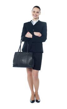 Beautiful american businesswoman holding a handbag