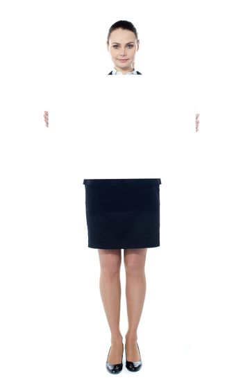 Woman showing billboard banner. White and blank with copyspace