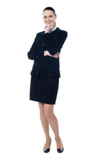 Attractive smiling corporate lady isolated over white