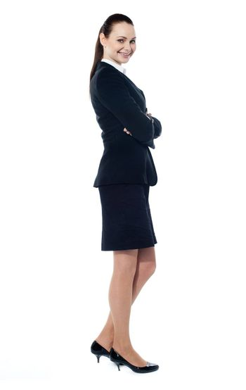 Beautiful sucessful businesswoman with folded arms, isolated on white background