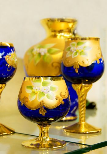 Blue hand-made glass covered with gold drawing