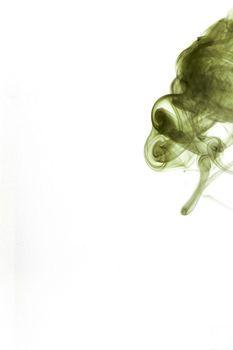 green smoke on white background portrait format