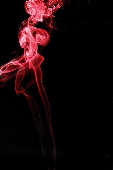 red smoke left on black background
