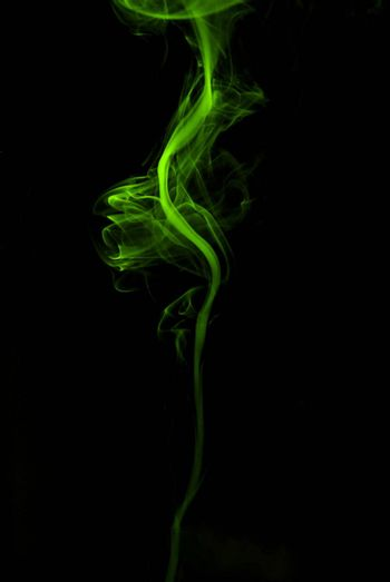 thin green colored smoke on black background