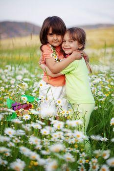 Portrait of little friends hugging