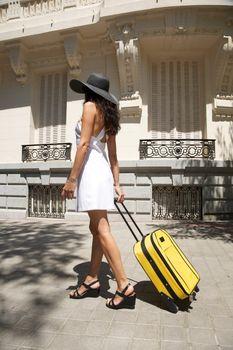 traveler side woman walking on sidewalk