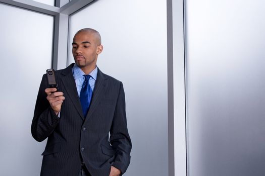 Businessman dialing a number on his cell phone
