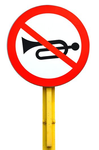 No horn traffic sign isolated on white background