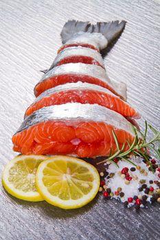 slice of fresh salmon with lemon , salt and pepper