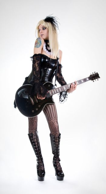 Sexy fetish girl with guitar