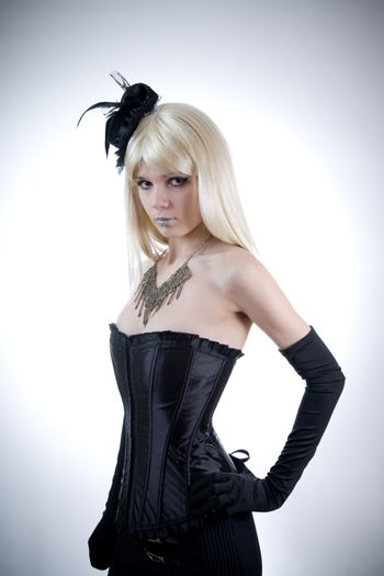 Young woman in black corset