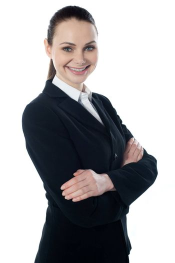 Portriat of corporate lady posing with folded arms isolated over white, smiling