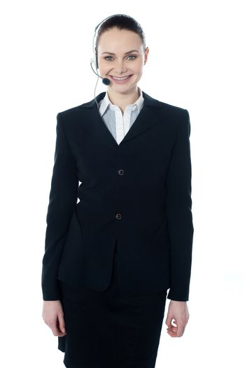 Customer service agent with headsets smiling at camera, isolated on white