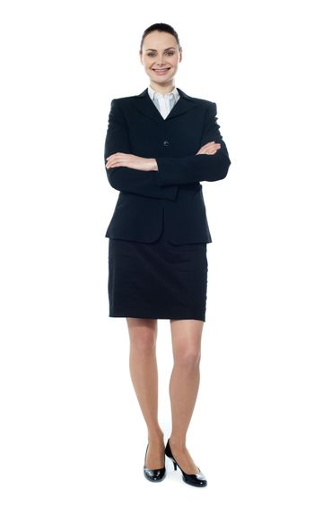 Businesswoman posing with folded arms isolated over white, full-length