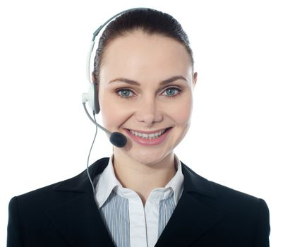 Closeup shot of call center female executive wearing headsets
