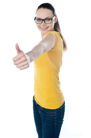 Glamourous teenager gesturing thumbs-up